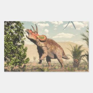 Pegatina Rectangular Triceratops que come en el árbol de la magnolia -