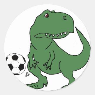 Pegatina Redonda Dinosaurio verde divertido de T-rex que juega a