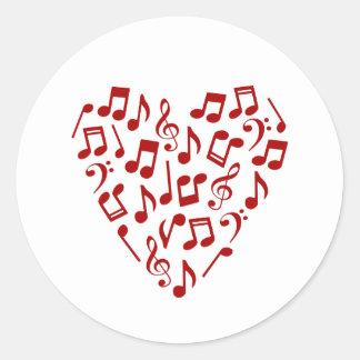 Pegatina Redonda El corazón rojo de la música observa a los