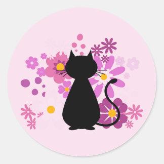 Pegatina Redonda El gato en rosa florece a los pegatinas (redondos)