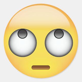 Pegatina Redonda La cara con el balanceo observa Emoji
