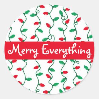 Pegatina Redonda La luz de navidad raya el saludo del día de fiesta