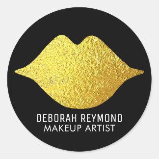 Pegatina Redonda labios del oro en el negro para una belleza del