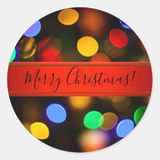 Pegatina Redonda Luces de navidad multicoloras. Añada el texto o
