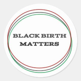 Pegatina Redonda Materias negras del nacimiento