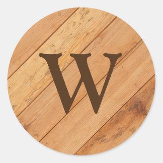 Pegatina Redonda Monograma con el fondo de madera