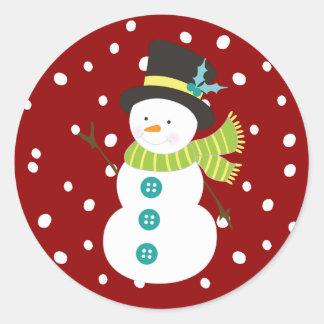Pegatina Redonda Navidad rojo que nieva del muñeco de nieve lindo