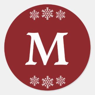 Pegatina Redonda Navidad rojo y monograma blanco con los copos de