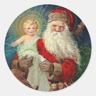 Pegatina Redonda Papá Noel que detiene al bebé Jesús