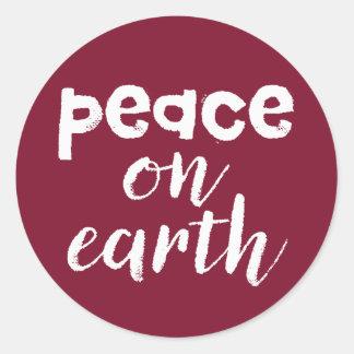 Pegatina Redonda Paz en la tierra