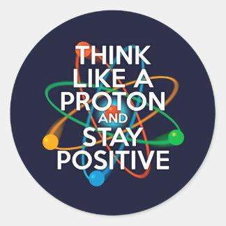 Pegatina Redonda Piense como un protón y permanezca positivo