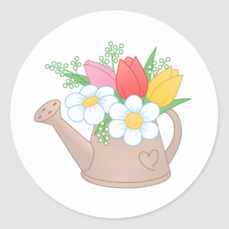 Pegatina Redonda Regadera del jardín con las flores