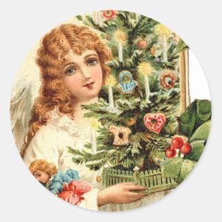 Pegatina Redonda Regalo de un ángel en el navidad