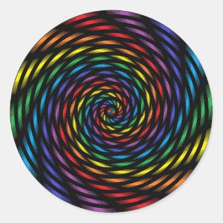 Pegatina Redonda Un molinillo de viento del arco iris en el