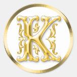 Pegatina redondo inicial de K en oro