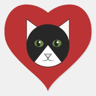 Pegatina rojo del corazón con la cara del gato del