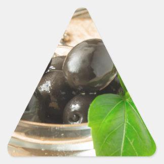 Pegatina Triangular Brown conservó en vinagre aceitunas en el viejo