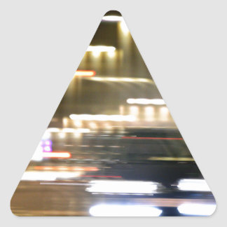 Pegatina Triangular Car in street in urban city lights with distortion
