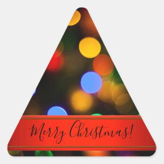 Pegatina Triangular Luces de navidad multicoloras. Añada el texto o