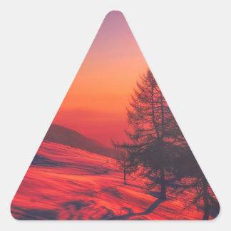 Pegatina Triangular Puesta del sol de la tarde Nevado