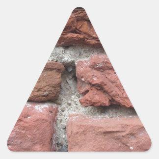 Pegatina Triangular Viejo fondo de la pared de ladrillo