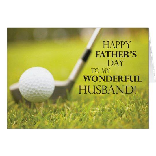 Pelota de golf del día de padre del marido en tarjeta de felicitación