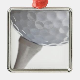 Pelota de golf y camiseta en plantilla modificada adorno navideño cuadrado de metal