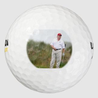 Pelotas de golf del triunfo (el Golfing del