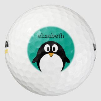 Pelotas De Golf esmeralda linda y negro del pingüino del dibujo