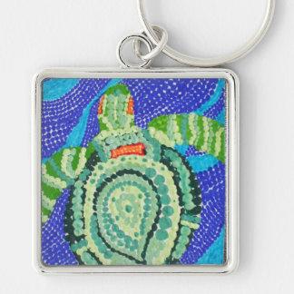 Pequeña tortuga con muchos puntos llavero cuadrado plateado