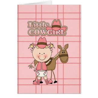 Pequeña vaquera del bebé con su tarjeta de