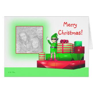 Pequeño duende del navidad en la foto de los tarjeta de felicitación