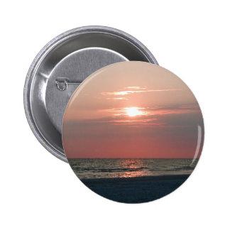 perno del botón con la foto de la puesta del sol