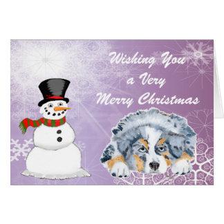 Perrito australiano del pastor con el muñeco de tarjeta de felicitación