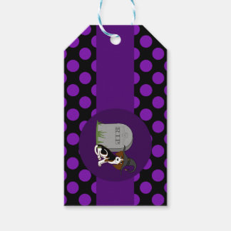 Perrito del beagle con la piedra grave y los etiquetas para regalos
