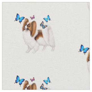 Perro de Papillon con la tela de algodón de las