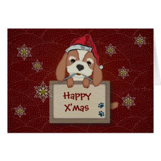 Perro de perrito lindo del navidad con el letrero felicitaciones