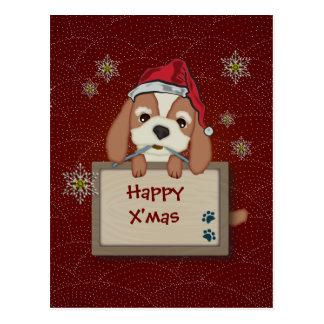 Perro de perrito lindo del navidad con el letrero tarjeta postal