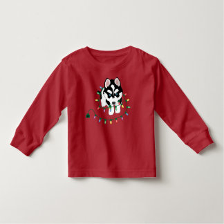 Perro esquimal con el suéter del navidad