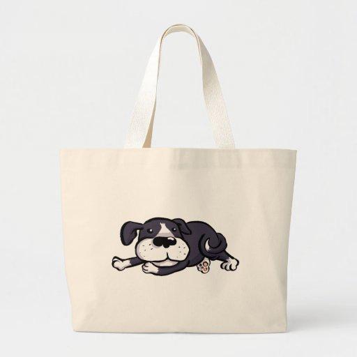 Perro lindo tirado todo hacia fuera bolsa
