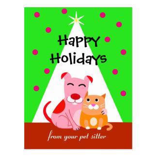 Perro y gato del día de fiesta del negocio del postal