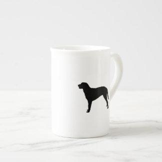 Perros revestidos rizados del amor de la silueta taza de té