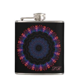 Petaca brillante en el frasco negro de la flor de la