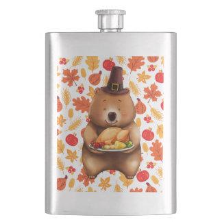 Petaca oso del pilgram con el fondo festivo