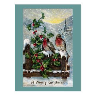 Petirrojos ingleses en navidad de una antigüedad postal