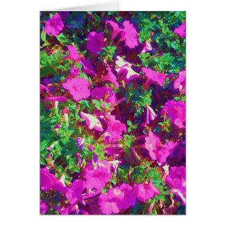 Petunias rosadas bonitas que saludan la tarjeta de