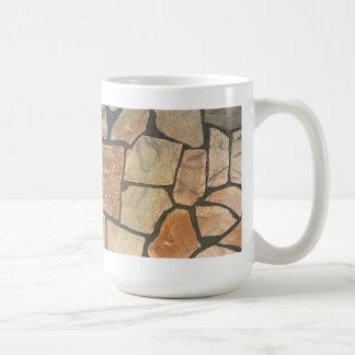 Piedra decorativa que pavimenta mirada taza