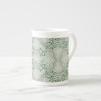 piel verde de serpiente taza de té