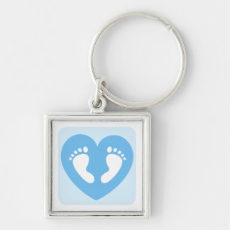 Pies o huellas azules del bebé en llavero del cora