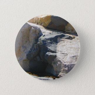 Pin del botón del dique de la roca del basalto